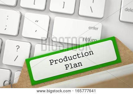 Production Plan written on Green Card Index Lays on Modern Metallic Keyboard. Closeup View. Blurred Image. 3D Rendering.