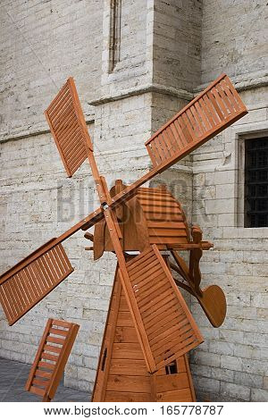 A little wooden mill for a decoration of a garden