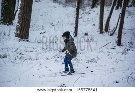 GRODNO BELARUS - JANUARY 15 2017. The boy in snow wood on cross-country skis.