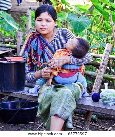 Kayan Mother And Daughter In Thailand Hill Village