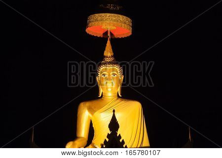 Golden buddha image with night time in thai temple