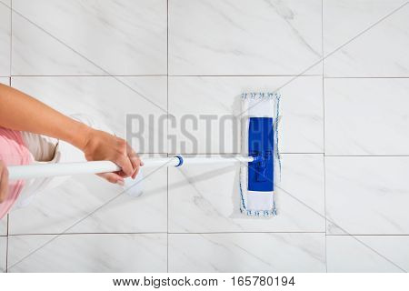 High Angle View Of Cleaning Service Woman Mopping The Cleaning Floor
