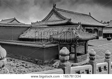 China Beijing. Black-and-white. Imperial Palace known as the Forbidden City. One of the halls of the palace. Overcast rainy day.
