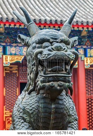 China Beijing . Summer emperor Palace . Figures of mythical creatures at the entrances to the building. Bronze Jilin symbolizes longevity and prosperity.