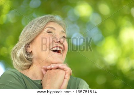 Portrait of a cheerful senior woman posing and smiling