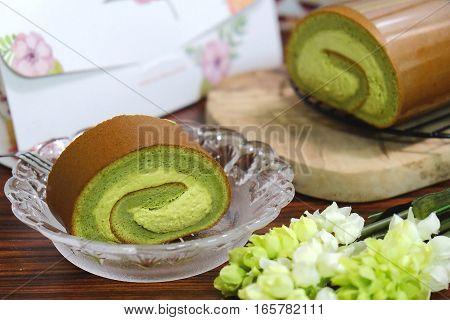 Green Tea Swiss Rolls On Glass Plate