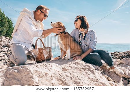 Romantic picnick on the sea side with beagle dog.