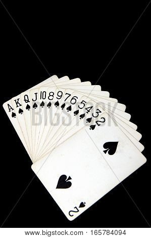 Playing cards top view isolated on black background