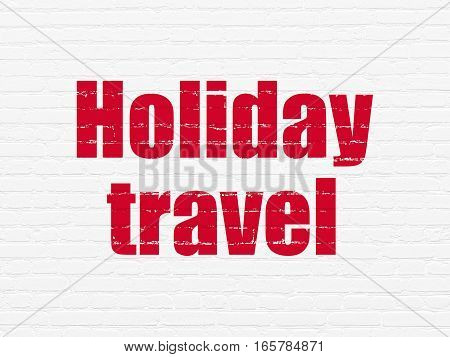 Tourism concept: Painted red text Holiday Travel on White Brick wall background