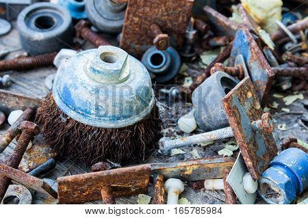 The Old industry equipment on wood background