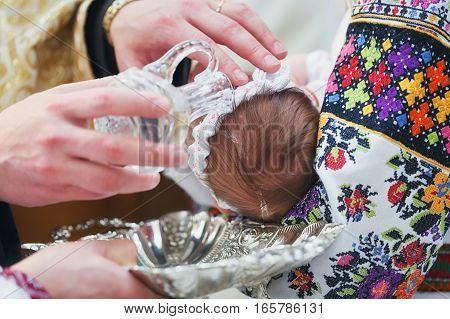 Christening newborn in Orthodox Church. Baby christening. Ceremony in Christian Church.