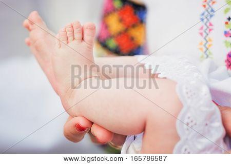 Newborn baby feet. Baby christening. Ceremony in Christian Church.