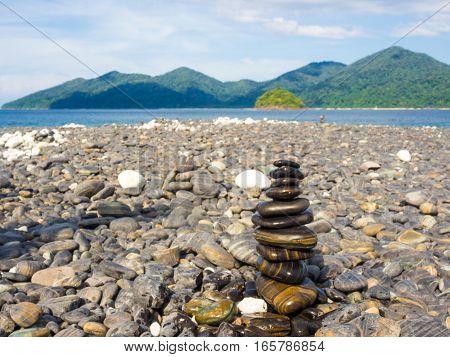 Balance Stone On Sea Beach Mountain Background