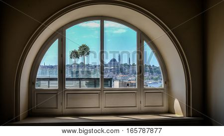 Istanbul, Turkey - March 13, 2013: Brief view of Eminonu and Golden Horn from a window