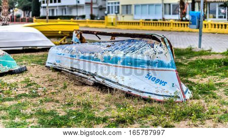Istanbul, Turkey - February 22, 2014: Small blue sailing boat upside down lays on the beach