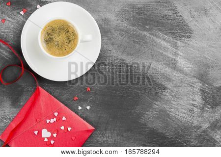 Espresso coffee in a white cup love letter on a dark background. Top view copy space. Food background