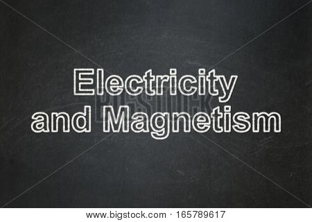 Science concept: text Electricity And Magnetism on Black chalkboard background