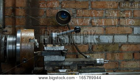 old lathe chuck. Electrical grinding machine. Foto