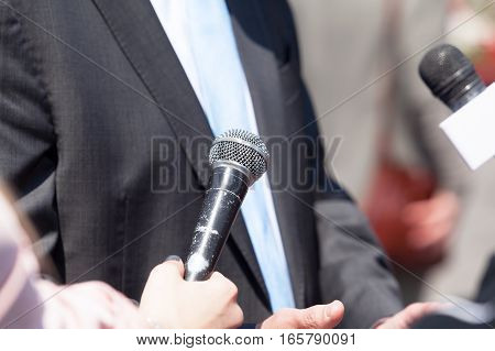 Media interview with businessman or politician. Press interview.