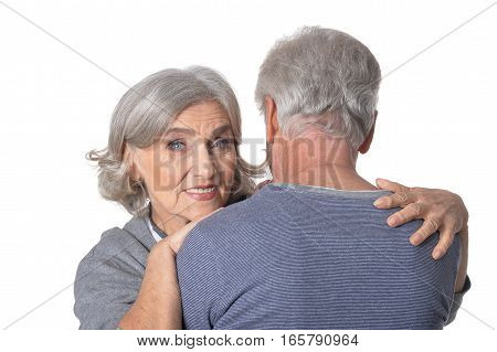 Portrait of senior couple hugging, Woman smiling isolated on white background
