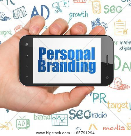Advertising concept: Hand Holding Smartphone with  blue text Personal Branding on display,  Hand Drawn Marketing Icons background, 3D rendering