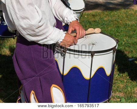 Drummer in Uniform Playing Snare Drum in Parade