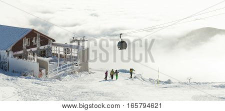 Cable Car Cabins Going Up And Down High In The Mountains At A Winter Sports Resort Area On A Cloudy