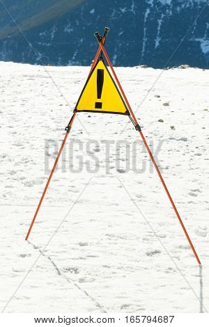 Caution sign at a of a ski resort