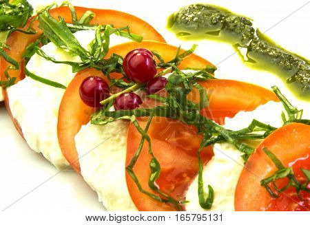 tomato salad with sour cream on a white background
