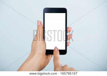 Close-up Of Woman Hand Holding Mobile Phone Showing Blank Screen