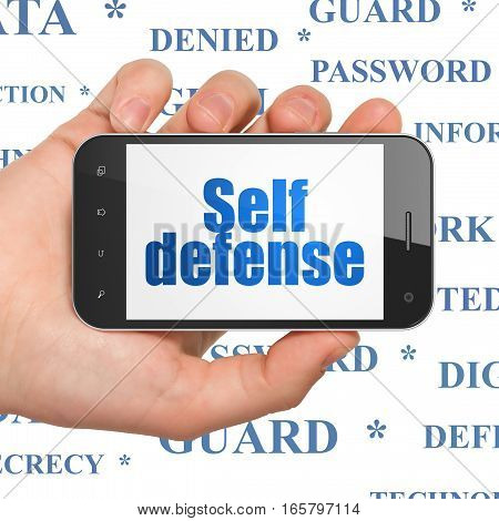 Privacy concept: Hand Holding Smartphone with  blue text Self Defense on display,  Tag Cloud background, 3D rendering
