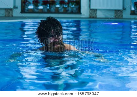 Cheerful Man Swims In Pool
