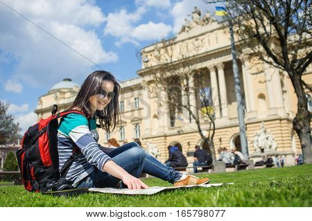 Young Female Tourist With Map And Camera