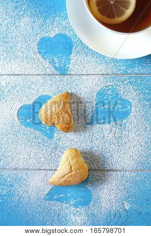 Valentine's Day: cup of lemon tea and heart cookies. Top view focus selective