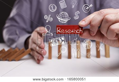 Business, Technology, Internet And Network Concept. Young Businessman Shows The Word: Research