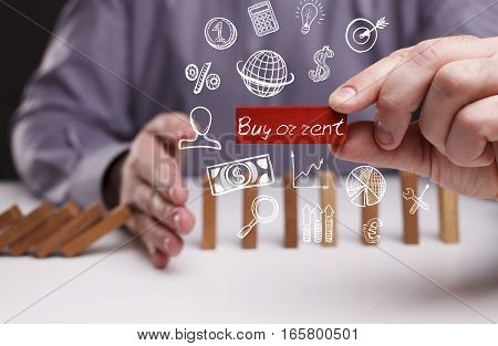 Business, Technology, Internet And Network Concept. Young Businessman Shows The Word: Buy Or Rent