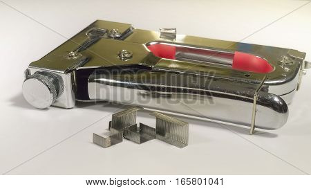 The staple gun on isolated white background