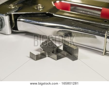 The staple gun on a white background close-up. Isolated.