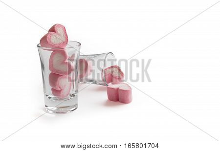Marshmallow pink heart shape in glass on white background