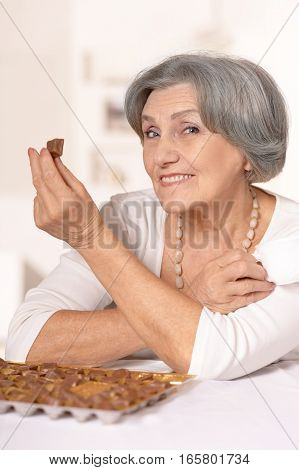 Portrait of a woman eating candies, close up