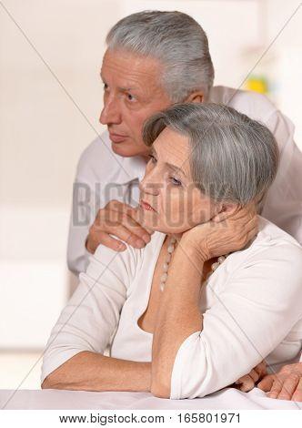 Portrait of a upset mature couple, close up
