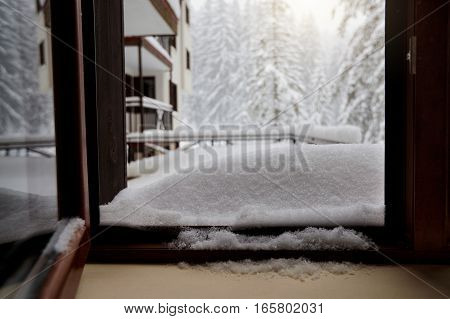 The view from  window of a house in winter forest.