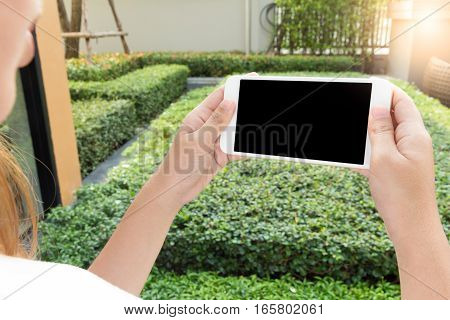 Concept of Woman hand holding phone and watching video on smart phone