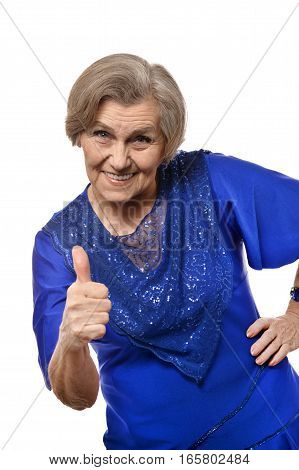 mature woman with thumb up posing against white