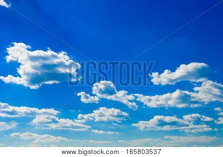 Fluffy white cumulus clouds with blue sky