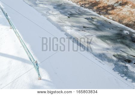 Frozen Water Of A Canal On Cold Winter Day