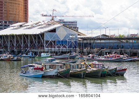 June 15, 2016 Panama City, Panama: small fishing boats floating on the water in front of the fish market
