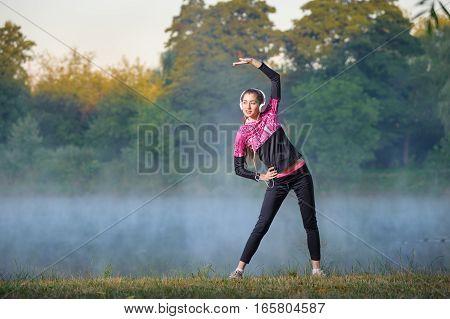 Woman Runner On Foggy Morning Near Lake