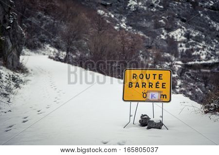 Road Blocked Sign On Snow Covered Mountain Road In Corsica