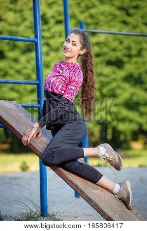 Beautifel Girl Doing Fitness Exercises In Park. Summer Time
